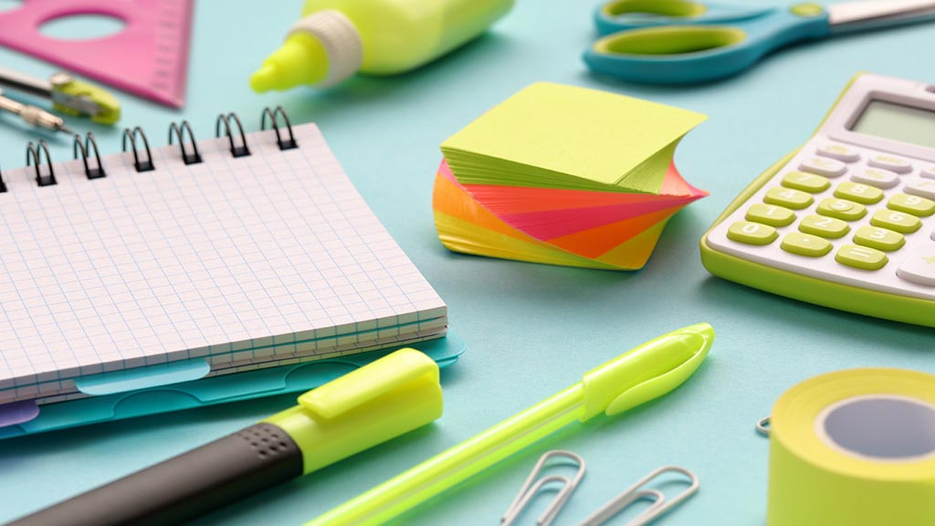 Stationery and office supplies on a blue paper background