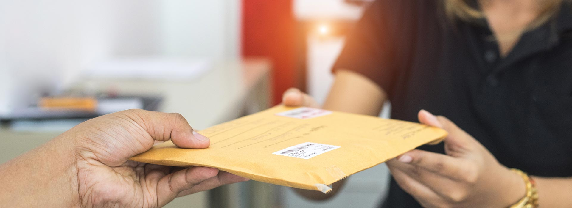 Male hand send mail envelope to the female of post office before